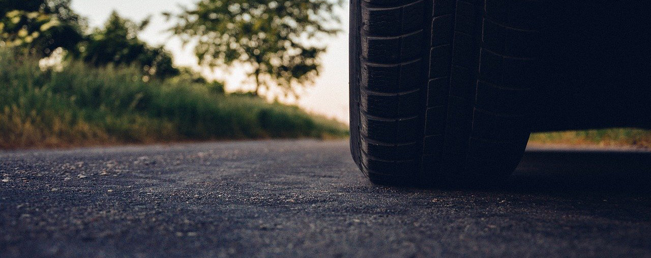 Car tyre on road